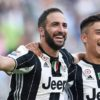 Juventus's Gonzalo Higuain, left, celebrates with his teammate Paulo Dybala after scoring during a Serie A soccer match between Juventus and Sassuolo at the Juventus Stadium in Turin, Italy, Saturday, Sept. 10, 2016. (Alessandro Di Marco/ANSA via AP)